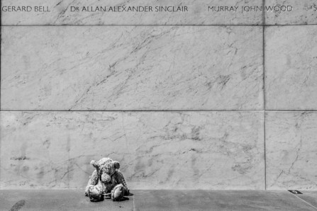Title: Memorial Bear, Pic of the week, Photographer: Keith Harrison, Judge's comments: (He is so sad. Give him a cuddle from me) Composition is well arranged and the negative space a strong component of the image. Black and white good choice.