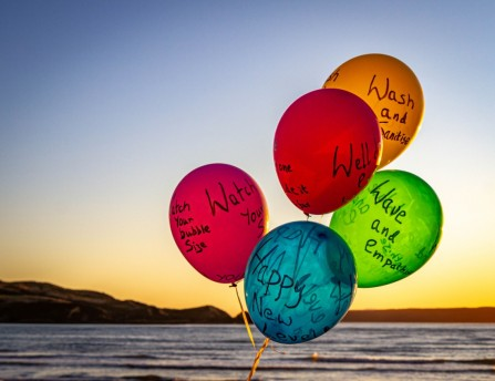Title: Happy Level 1!, 3rd, Photographer: Brian Wesley-Smith, Judge's Comments: Great glow in the sky has infused the colourful balloons with light. A good way to get your message across and don't we all hope to get back to level 1 as soon as possible.