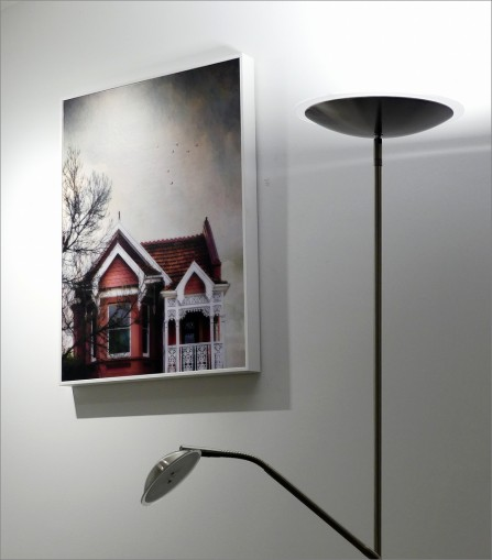 Title: Decorum, 4th=, Photography by Paddy Flanagan, Judge's Comments: Someone has looked for something different. The light has given strong angles in juxtaposition to the picture of the house. I wonder why you did not turn the reading lamp on as well which would have evened the lighting at the bottom of the image. Well seen.